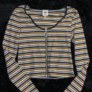 Long sleeve yellow, black, and white zip up shirt